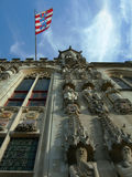Gothic Church. The flag flies proudly from a gothic church in Brugge, Belgium Stock Photos
