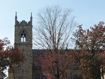Gothic church as leaves fall around it Royalty Free Stock Photo