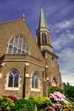 Gothic Church in Bellingham, WA. With blue sky and whispy clouds Royalty Free Stock Photos