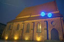 The Gothic church and Christmas decorations at night Royalty Free Stock Image
