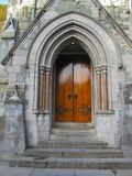 The Gothic Church Door at Kylemore Abbey. The Gothic Church at Kylemore Abbey. Along the shores of Lough Pollacapull the neo-Gothic Church has been described as Royalty Free Stock Image