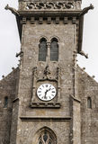 Gothic Church in French brittany. With tower and clock it is a vertical image on a cloudy day Royalty Free Stock Images