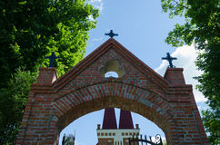 Gothic church gate with metallic crosses Stock Image