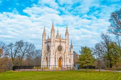 Free Gothic Church In An Autumn Park With A Picturesque Blue Sky. Royalty Free Stock Photo - 102063415
