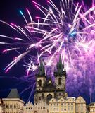 Church of Mother of God in front of Tyn in Old Town Square and holiday fireworks , Prague, Czech Republic Stock Photos