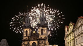 The gothic Church of Mother of God in front of Tyn in Old Town Square and holiday fireworks , Prague, Czech Republic stock video footage