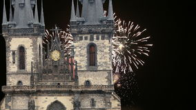 The gothic Church of Mother of God in front of Tyn in Old Town Square and holiday fireworks , Prague, Czech Republic stock video