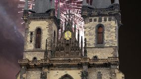 The gothic Church of Mother of God in front of Tyn in Old Town Square and holiday fireworks , Prague, Czech Republic.  stock video