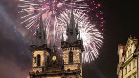 The gothic Church of Mother of God in front of Tyn in Old Town Square and holiday fireworks , Prague, Czech Republic.  stock video footage