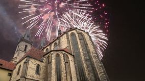 The gothic Church of Mother of God in front of Tyn in Old Town Square and holiday fireworks , Prague, Czech Republic.  stock footage