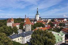 Oleviste Church and Old Town in Tallinn royalty free stock images