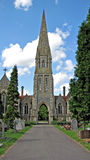 Gothic church spire. Photo of a gothic church spire and cemetery grounds Stock Photos