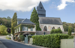 Gothic church. Street in a village in northern France, with trees in the background on a sunny day, you can see a gothic church Stock Photography