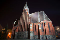 Gothic church with tower in Poznan by night Stock Photos