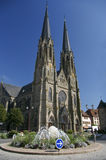 Gothic church and traffic roundabout in france. Gothic church and traffic roundabout with water fountain flowers in france on sunny day Stock Photography