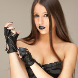 Gothic corset. Young attractive woman dressed in black corset Stock Photos
