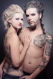 Gothic couple. Pierced tattooed man and woman with old-fashioned make-up and hairstyle Royalty Free Stock Images