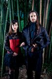 Gothic couple. In bamboo forest stock image