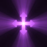 Gothic Cross symbol light flare. A flower (fleury) armed cross sign with powerful light halo. Extended flares for background cropping Stock Image