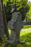 Gothic cross and tomb in cemetery at Saint-Hubert church, Aubel Stock Photo