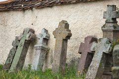 Gothic crosses a Roman Catholic cemetery. Gothic cross leaning against fence cemetery Stock Photos