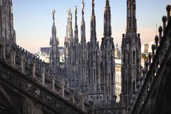 Gothic details and towers on top roof of the Milan royalty free stock photos