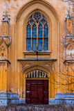 Gothic door of a complex of buildings Imperial stables. Peterhof. Door and window of the building Imperial Stables (1855, architect Benoit). The Palace and Park Royalty Free Stock Photography