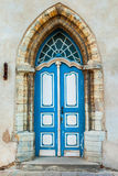 Gothic door on a medieval building facade Royalty Free Stock Photography