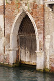 Gothic doorway on canal, venice Stock Images