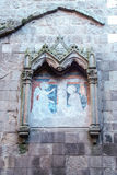 Gothic edicule with annunciation on a stone wall Stock Photo