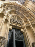 Gothic entrance. Heavy Gothic ornamented doorway, with open door Royalty Free Stock Photography