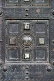 Gothic entrance. Section of an old metal gothic door Stock Photos