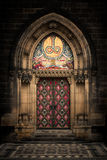 Gothic entrance. Entrance door of St. Peter and Paul church in Prague Stock Photos