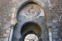 Gothic entrance door to a walled city. Ancient arch of great artistic value. Gothic door in Toledo Spain. It gives access to a walled city of great royalty free stock photos