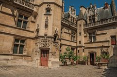 Gothic facade of the Cluny Museum, with a rich collection of medieval art artifacts in Paris. stock photography