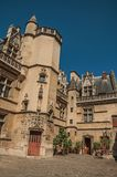 Gothic facade of the Cluny Museum, with a rich collection of medieval art artifacts in Paris. stock photo