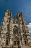 Gothic facade of St. Michael and St. Gudula's Cathedral and blue sunny sky in Brussels. stock photos