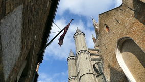 Gothic facade and tall belfry of the Church of Our Lady, Bruges, Belgium stock footage