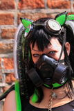 Gothic fetish girl with gasmask. Beautiful gothic girl with gasmask as protest against air pollution during the gothic festival summer darkness in the dutch city Royalty Free Stock Photography