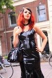 Gothic fetish girl street fashion black pvc dress stock image