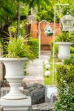Gothic flower pot in garden. Stock Photo