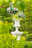 Gothic flower pot in garden. Royalty Free Stock Photos