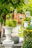 Gothic flower pot in garden. Stock Photos