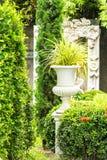 Gothic flower pot in garden. Royalty Free Stock Photos