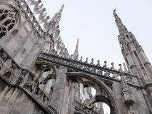 Gothic Flying Buttresses of Milan Cathedral. Low Angle Architectural Detail of Italian Gothic Flying Buttresses and Spires of Historic Milan Cathedral Church Royalty Free Stock Photo