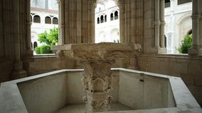 Gothic fountain Alcobaca Monastery. Alcobaca, Portugal - August 15, 2017: renaissance water basin within the Gothic fountain house in the cloister of Monastery stock video