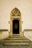 Gothic gate with the ornamental rose window Royalty Free Stock Images