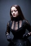 Gothic girl. Pretty gothic girl in corset stock images