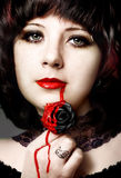 Gothic Girl. Portrait of beautiful gothic girl with black rose stock images
