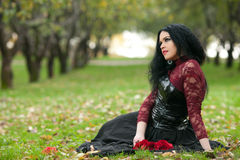 Gothic girl in the autumn park Stock Image